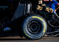 Feb 9, 2018; Pomona, CA, USA; Detailed view to the smeared Goodyear logo on the rear tire of NHRA funny car driver John Force after he exploded the carbon fiber body off his car and hit the wall during qualifying for the Winternationals at Auto Club Raceway at Pomona. Force would walk away from the incident. Mandatory Credit: Mark J. Rebilas-USA TODAY Sports