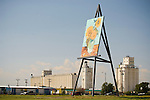 Goodland, Kanasas' 24x32 foot Van Gough Sunflower painting on easel painting by Canadian artist Camron Cross in 2002; grain elevators