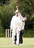 Matt Davis bowls for Shepherds Bush during the Middlesex County Cricket League Division Two game between Harrow St Mary's and Shepherds Bush at<br /> Harrow on Sat July 19, 2014