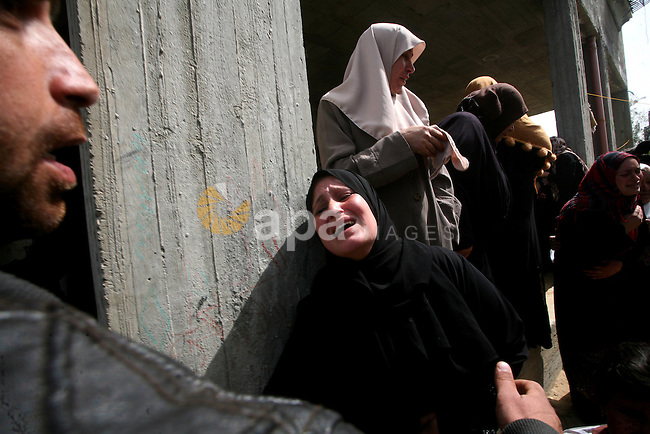 Palestinians women react during the funeral of 12 year old Ayoub Assalya killed in an Israeli airstrike in Jabaliya Refugee Camp, Gaza Strip Sunday, March 11, 2012. The worst round of violence in more than a year between Israel and Gaza Strip Palestinians deepened Sunday with deadly Israeli airstrikes and a barrage of rockets fired into the Jewish state. Photo by Ashraf Amra
