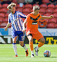DUNDEE UTD'S BARRY DOUGLAS TRIES TO GET AWAY FROM KILMARNOCK'S JAMES DAYTON