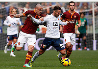 Calcio, Serie A: Roma-Genoa. Roma, stadio Olimpico, 12 gennaio 2014.<br /> Genoa midfielder Andrea Bertolacci, center, is challenged by AS Roma midfielder Radja Nainggolan, of Belgium, as AS Roma midfielder Miralem Pjanic, of Bosnia, right, looks on during the Italian Serie A football match between AS Roma and Genoa, at Rome's Olympic stadium, 12 January 2014.<br /> UPDATE IMAGES PRESS/Isabella Bonotto