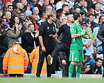 Manchester City's Pep Guardiola argues with Liverpool's Jurgen Klopp over the sending off during the premier league match at the Etihad Stadium, Manchester. Picture date 9th September 2017. Picture credit should read: David Klein/Sportimage