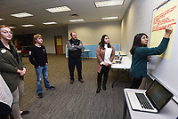 NWA Democrat-Gazette/FLIP PUTTHOFF <br />Sidra Nadeem (right) and Katherine Caceres (second from right), students at Rogers New Technology High School, take comments Wednesday Nov. 28 2018 from community residents including Payne Brewer (center) at the Community in Action meeting.