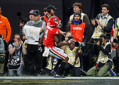 January 8th 2018, Atlanta, GA, USA; Georgia Bulldogs wide receiver Mecole Hardman (4) scores a touchdown during the College Football Playoff National Championship Game between the Alabama Crimson Tide and the Georgia Bulldogs on January 8, 2018 at Mercedes-Benz Stadium in Atlanta, GA.