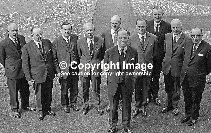 Northern Ireland Cabinet, June, 1966, Prime Minister, Captain Terence O'Neill (front). Others from left: John Andrews, Minister in and Leader of the Senate, Captain William Long, Minister of Education, Brian McConnell, leader of the House of Commons, Brian Faulkner, Minister of Commerce, Herbert Kirk, Minister of Finance, William Craig, Minister of Home Affairs, Major James Chichester-Clark, Minister of Agriculture,  William Morgan, Minister of Health and Social Services, and William Fitzsimmons, Minister of Development. 196606000170.<br />