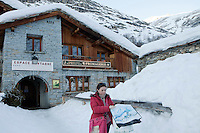 A customer leaves the village cheese co-op in Bonneval sur Arc, Savoie, France, 17 February 2012.