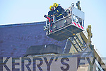 Firemen examine the damage caused by a fire in St Marys Cathedral, Killarney, on Monday morning.