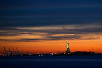 BROOKLYN, NY - APRIL 09: The Statue of Liberty is seen from Brooklyn Bridge park during the sunset on a warm day on April 09, 2017 in Brooklyn, New York. Photo by VIEWpress/Eduardo MunozAlvarez