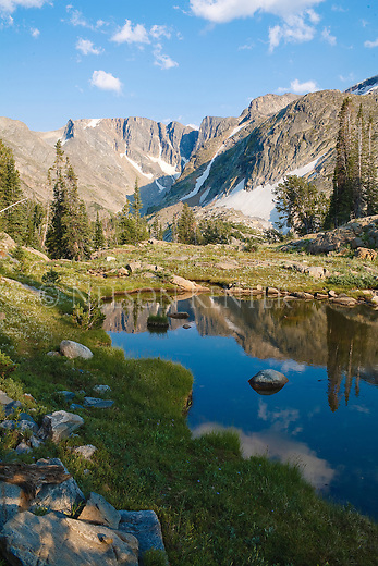 High rocky peaks and a small pond along the East Rosebud trail in Montana's Beartooth Wilderness
