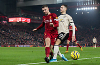 Manchester United's Diogo Dalot is tackled by Liverpool's Jordan Henderson<br /> <br /> Photographer Alex Dodd/CameraSport<br /> <br /> The Premier League - Liverpool v Manchester United - Sunday 19th January 2020 - Anfield - Liverpool<br /> <br /> World Copyright © 2020 CameraSport. All rights reserved. 43 Linden Ave. Countesthorpe. Leicester. England. LE8 5PG - Tel: +44 (0) 116 277 4147 - admin@camerasport.com - www.camerasport.com