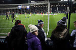 Home supporters behind one of the goals watching players warming up before West Bromwich Albion take on Leeds United in a SkyBet Championship fixture at the Hawthorns. Formed in 1878, the home team were relegated from the English Premier League the previous season and were aiming to close the gap on the visitors at the top of the table. Albion won the match 4-1 watched by a near-capacity crowd of 25,661.