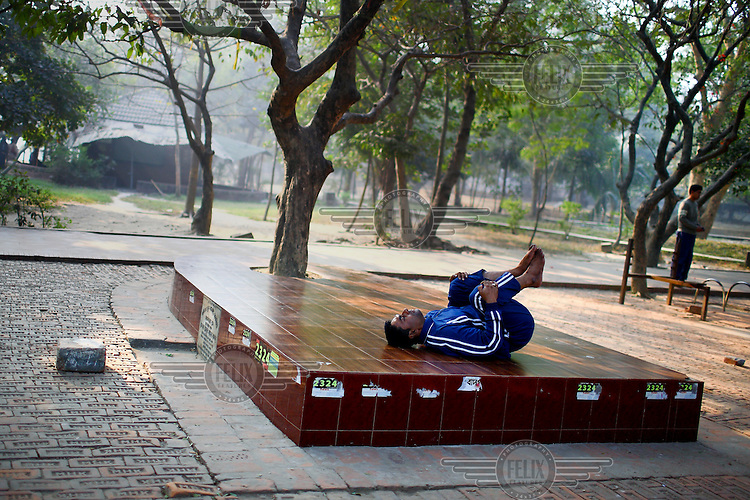 A man exercises in Dhanmondi Lake Park.