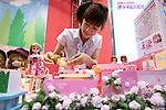 July 15, 2010 - Tokyo, Japan - A booth assistant introduces the 'Licca' serie released by Takara Tomy, during the International Tokyo Toy Show 2010 at Tokyo Big Sight, Japan, on July 15, 2010.The toy fair, held from July 15 to July 18, attracts buyers and visitors by introducing the latest products presented by various toymakers from Japan and abroad.