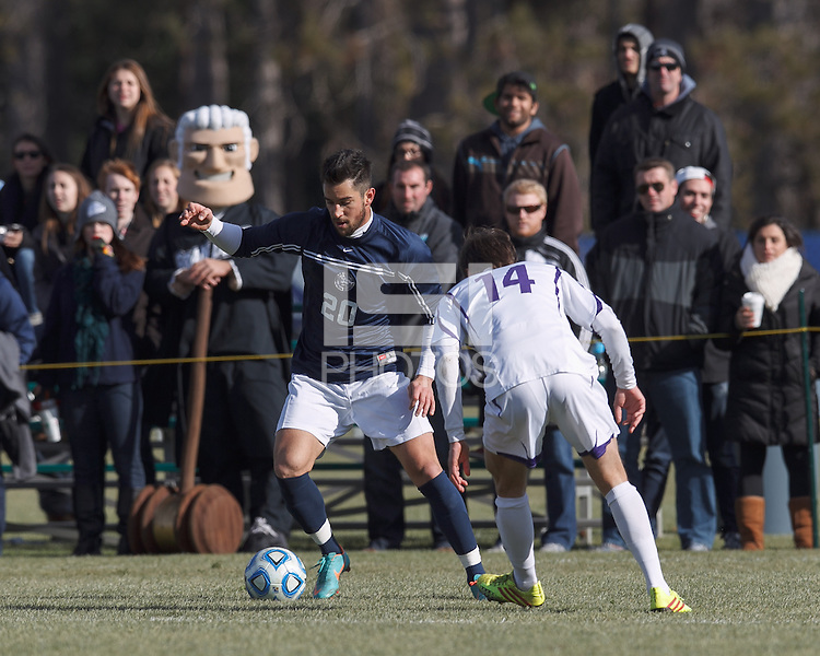 Brandeis forward/midfielder Michael Soboff (20) dribbles. NCAA Division III Sectionals. Williams College (white) defeated Brandeis University (blue/white), 2-0, on Hitchcock Field at Amherst College on November 23, 2013.