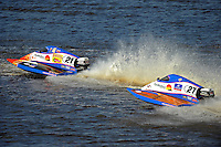 Jose Mendana, Jr., (#21) and brother Carlos Mendana, (#27) race for position. (SST-45 class)