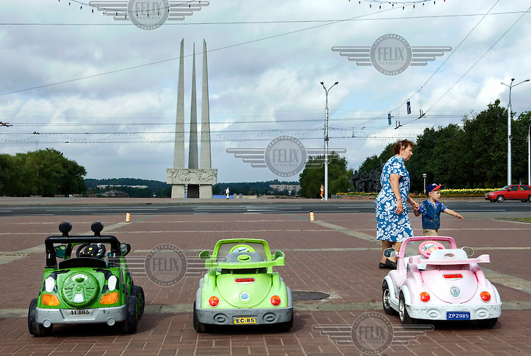 Children's play cars at the memorial in tribute to the Red Army's liberation of Belarus in World War Two (WWII).