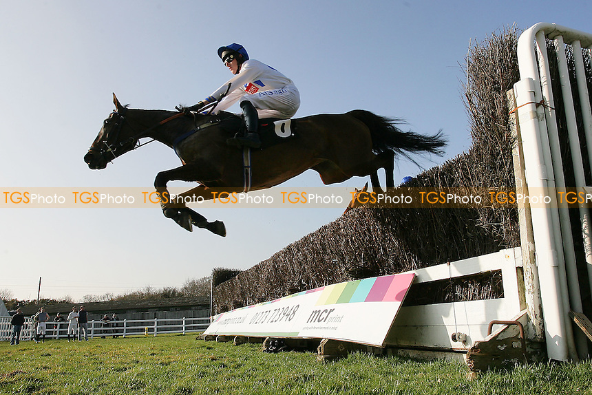 Kitchen Loan ridden by Sam Jones jumps during the SVS Securities Preferred Partnership For IFAs Novices Handicap - Horse Racing at Plumpton Racecourse, East Sussex - 12/03/12 - MANDATORY CREDIT: Gavin Ellis/TGSPHOTO - Self billing applies where appropriate - 0845 094 6026 - contact@tgsphoto.co.uk - NO UNPAID USE.