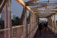 People walk in a pedestrian overpass at HUDA City Centre in Gurugram, Haryana, India, on Mon., December 10, 2018.