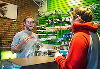 Budtender Chris Nagel (cq) shows marijuana samples to Brian Hamel (cq) of Denver,  at the Natural Remedies marijuana store in Denver, Colorado, Thursday, November 14, 2013. <br /> <br /> Photo by Matt Nager