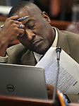 Nevada Assemblyman Tyrone Thompson, D-North Las Vegas, works in committee at the Legislative Building in Carson City, Nev., on Thursday, March 19, 2015. <br /> Photo by Cathleen Allison