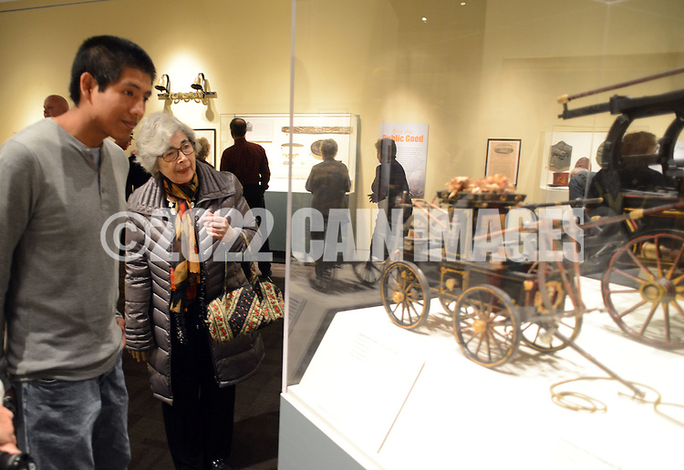 """Michael Petruski (L) of Toms River, new Jersey and Sylva Baker of Doylestown, Pennsylvania view a model of an old fire wagon during a special preview of the Mercer Museum's new exhibit """"To Save Our Fellow Citizens:"""" Volunteer Firefighting, 1800-1875 Thursday April 23, 2015 in Doylestown, Pennsylvania. The exhibit tells the exciting story Philadelphia's volunteer firefighters and fire companies as the city grew and expanded during the 1800's.  (Photo by William Thomas Cain/Cain Images)"""