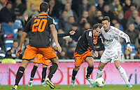 Real Madrid's Mesut Özil against Valencia's Andres Guardado during King's Cup match. January 15, 2013. (ALTERPHOTOS/Alvaro Hernandez) /NortePhoto