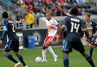 CHESTER, PA - OCTOBER 27, 2012:  Carlos Valdés (2), Amobi Okugo (14) and Brian Carroll (7) of the Philadelphia Union surround  Thierry Henry (14) of the New York Red Bulls during an MLS match at PPL Park in Chester, PA. on October 27. Red Bulls won 3-0.