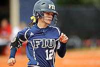11 February 2012:  FIU's Erika Arcuri (12) runs to first as the University of Louisville Cardinals defeated the FIU Golden Panthers, 4-2, as part of the COMBAT Classic at the FIU Softball Complex in Miami, Florida.