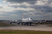 A Boing 747 airliner (Jumbo jet) belonging to British Airways lines up on a taxi-way with other airliners before taking off from Heathrow Airport, London, UK Sunday August 17th 2014