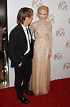 HOLLYWOOD, CA - JANUARY 28: Singer-musician Keith Urban (L) and actress Nicole Kidman arrive at the 28th Annual Producers Guild Awards at The Beverly Hilton Hotel on January 28, 2017 in Beverly Hills, California.