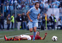 Calcio, finale di Coppa Italia: Roma vs Lazio. Roma, stadio Olimpico, 26 maggio 2013..Lazio midfielder Senad Lulic, of Bosnia, right, chases the ball as AS Roma defender Marquinhos, of Brazil, falls on the pitch during the Italian Cup football final match between AS Roma and Lazio at Rome's Olympic stadium, 26 May 2013..UPDATE IMAGES PRESS/Isabella Bonotto....