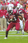 South Carolina Gamecocks tailback Marcus Lattimore (21) runs for more yardage against Georgia.