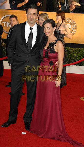GILLES MARINI & CAROLE MARINI.Arrivals at the 16th Annual Screen Actors Guild Awards Held At The Shrine Auditorium in Los Angeles, California, USA..January 23rd, 2010 .SAG SAGs full length black suit jacket dress married husband wife red one shoulder .CAP/RKE/DVS.©DVS/RockinExposures/Capital Pictures