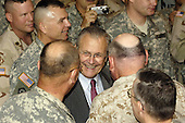 United States Army soldiers of Multi-National Forces-Iraq surround US Secretary of Defense Donald H. Rumsfeld as he meets with them in Baghdad, Iraq, on April 27, 2006.  Rumsfeld and US Secretary of State Condoleezza Rice made an unannounced visit to Iraq to meet jointly with Iraq's newly designated Prime Minister Jawad al-Maliki to show support for the continuing process of building a new Iraqi government. <br /> Mandatory Credit: Chad J. McNeeley / DoD via CNP