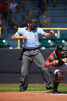Umpire Matt Snodgrass strike three call during a game between the Great Lakes Loons and Clinton LumberKings on August 16, 2015 at Ashford University Field in Clinton, Iowa.  Great Lakes defeated Clinton 3-2 in ten innings.  (Mike Janes/Four Seam Images)