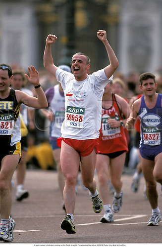 A male runner celebrates coming up the finish straight, Flora London Marathon, 990418. Photo: Glyn Kirk/Action Plus...1999 marathons distance running runner runners.athletics.celebrate celebrating celebration joy