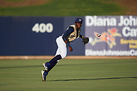 AZL Brewers Gold center fielder Larry Ernesto (7) throws to the infield during an Arizona League game against the AZL Brewers Blue on July 13, 2019 at American Family Fields of Phoenix in Phoenix, Arizona. The AZL Brewers Blue defeated the AZL Brewers Gold 6-0. (Zachary Lucy/Four Seam Images)