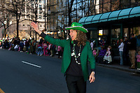 Mecklenburg County Commissioner Jennifer Roberts waves to  people who turned out to watch the annual St. Patrick's Day Parade in Uptown/Downtown Charlotte, North Carolina.