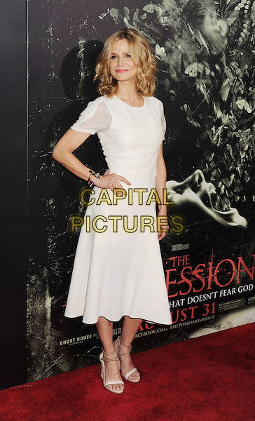 "Kyra Sedgwick.""The Possession"" Los Angeles Premiere held at Arclight Cinemas, Hollywood, California, USA..August 28th, 2012.full length dress open toe shoes white sheer hand on hip.CAP/ROT/TM.©Tony Michaels/Roth Stock/Capital Pictures"