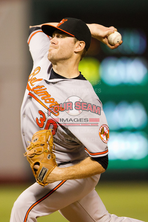 Baltimore Orioles pitcher Chris Tillman #30 throws the ball during the Major League Baseball game against the Texas Rangers on August 21st, 2012 at the Rangers Ballpark in Arlington, Texas. The Orioles defeated the Rangers 5-3. (Andrew Woolley/Four Seam Images).