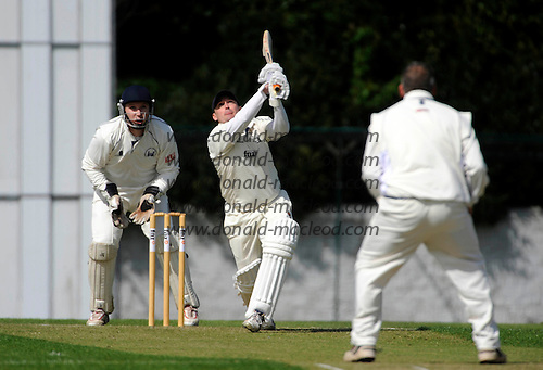 Scottish National Cricket League - Grange V Uddingston at Reaburn Place, Edinburgh - Opening match of the new season for last years Champions hosting Uddy - Grange batsman Cammy Coles launches the ball skywards off the bowling of Uddy veteran Mark Townson, hoping for a boundary only to be caught by Hoffmann at deep mid off - Picture by Donald MacLeod 1 May 2009