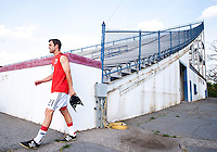 Daniel Woolard (21) of D.C. United walks out to the field before a third round match in the US Open Cup at City Stadium in Richmond, VA.  D.C. United advanced on penalty kicks after tying the Richmond Kickers, 0-0.