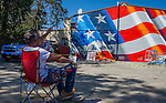 "Artist Scott LoBaido painting a flag mural in Antioch, California on Thursday, April, 2, 2015.  LoBaido, from New York, is traveling around the United States painting flag murals along the way.  His project is called, ""Painting Flags Across America"" and his mission is to paint one flag mural on one one veteran's post in every state.  His mural is on the back wall of the VFW (Veterans of Foreign Wars) building in Antioch on 6th street.  Photo/Victoria Sheridan"