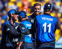 Bowler Tim Southee celebrates Daniel Vettori's catch of Stuart Broad during the ICC Cricket World Cup one day pool match between the New Zealand Black Caps and England at Wellington Regional Stadium, Wellington, New Zealand on Friday, 20 February 2015. Photo: Dave Lintott / lintottphoto.co.nz