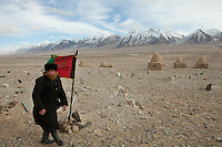 A new Khan comes to give respect to his father, the late Haji Abdul Rashid Khan who had led his people for 30 years at the time of his death. He was the last khan, not just among the Afghan Kyrgyz, but among any group of Kyrgyz, or Turkic-speakers, anywhere. His son, holding the Afghan flag on his father's simple tomb, recently took over the title of Khan. But being young and inexperienced, he has so far failed to rally his community.