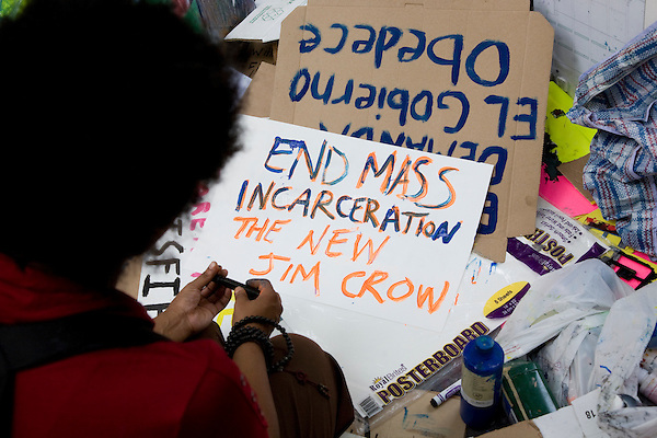 Protesters make signs as they continue to gather in Liberty Square in lower Manhattan, New York on 30 September 2011, day 13 of Occupy Wall Street, a resistance movement targeting corporate greed and corruption.