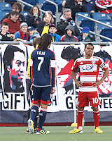 Yellow Card: FC Dallas midfielder David Ferreira (10)..  In a Major League Soccer (MLS) match, FC Dallas (red) defeated the New England Revolution (blue), 1-0, at Gillette Stadium on March 30, 2013.