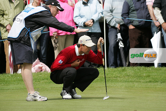 Padraig Harrington and his caddy line up his putt on the 9th green during the final round of the Irish Open on 20th of May 2007 at the Adare Manor Hotel & Golf Resort, Co. Limerick, Ireland. (Photo by Eoin Clarke/NEWSFILE).