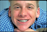 smiling adolescent boy with braces